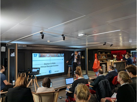 Ahmad presenting at Techfugees conference